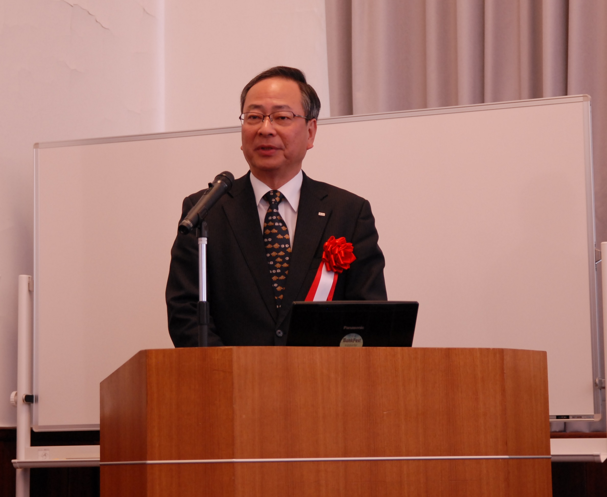 Mr. Sadao Mino, President of the Council for Cooperative Center